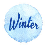 Blue watercolor circle with word winter isolated on a white background. Watercolor. Sticker, label, round shape with text winter. Thanks, thanking stock illustration