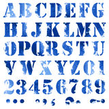 Blue watercolor letters. Grunge full alphabet and numbers in blue colors Stock Image