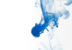 Blue watercolor paint drops in water with white background Stock Photo