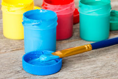 Blue watercolor paints with paintbrush Stock Photography