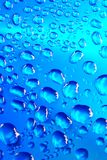 Blue waterdrops. Clean blue waterdrops macro background stock photo