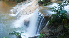 Blue Waterfall. A beautiful background of a waterfall in blue and green color Stock Photos