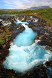 Blue waterfall Brúarfoss Royalty Free Stock Image