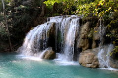 A blue waterfall in jungle, Thailand Stock Images