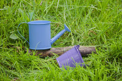 Blue watering can and bucket Royalty Free Stock Photo