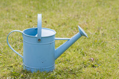Blue watering can Royalty Free Stock Image