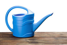 Blue watering can. Isolated on white background royalty free stock image