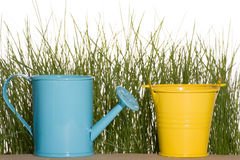Blue watering can and yellow bucket Royalty Free Stock Image