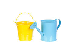 Blue watering can and yellow bucket Stock Photography