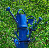 Blue watering cans Royalty Free Stock Photo