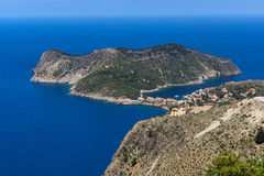 Blue waters in Assos village and beautiful sea bay, Kefalonia, Greece Royalty Free Stock Photography