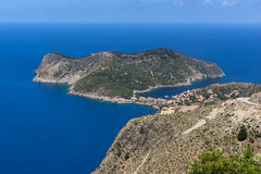 Blue waters in Assos village and beautiful sea bay, Kefalonia, Greece Stock Photography