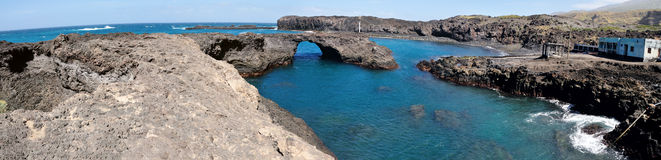 Blue Waters of Baia. Panoramic view of Salinas and the entire Baia with its blue clear water pool under the volcanic arch found on the island of Fogo, Cabo Verde Royalty Free Stock Photography