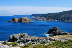 Blue waters of Biscayan Cove. Bright blue waters and rocky coastline of Biscayan Cove, Newfoundland, Canada Stock Photo