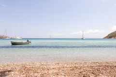 Blue waters and boat Stock Photos