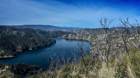 Blue waters of Lake Berryessa and 2015 wragg fire damage Royalty Free Stock Photo