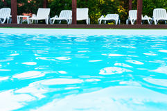 Blue waters in outdoor swimming pool Stock Photos