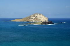Blue Waters And Rabbit Island. Blue water and blue skies surround Rabbit Island just off the shores of Oahu, Hawaii Royalty Free Stock Images