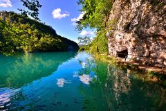 Blue waters and reflections at Plitvice Lakes, Croatia Royalty Free Stock Image