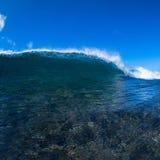 Blue Wave. Blue ocean wave breaking in Maui, Hawaii stock photos