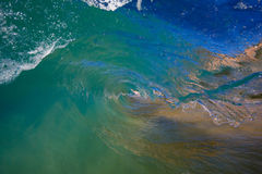 Blue Wave. Big Blue Wave in the Tube, Breaking on the Beach, Surfing Barrel stock image