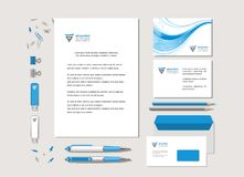 Blue wave and the abstract sign. The light corporate style with a blue wave and the abstract sign. Samples of business cards, a flash card, a pen, an envelope Royalty Free Stock Photography