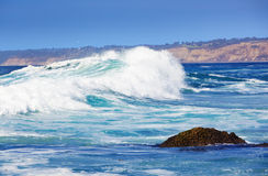 Blue Wave Breaks On La Jolla California Beach. Big Blue Wave Breaks On La Jolla California's Pacific Coast ~ Ocean, Torry Pines Cliffs with Sun and Clear Sky Royalty Free Stock Photography