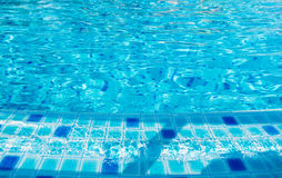 Blue wave of Clear water on poolside Royalty Free Stock Images