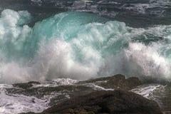 Blue wave crashing at Cape Spear