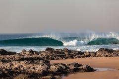 Blue Wave Crashing Rocks Beach Royalty Free Stock Photography