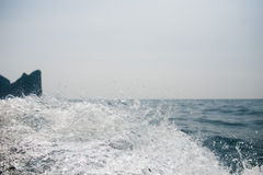 Blue wave and gray sky Stock Image
