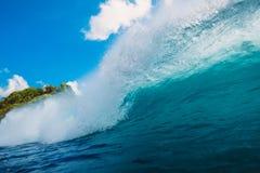 Blue wave in ocean. Breaking barrel wave in Bali. Blue wave in ocean. Breaking barrel wave Stock Photo