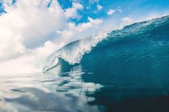 Blue wave in ocean. Breaking wave and sky with clouds in Bali. Blue wave in ocean. Breaking wave and sky with clouds Royalty Free Stock Photography
