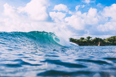 Blue wave in ocean and sky with clouds. Surf in Bali Royalty Free Stock Photo