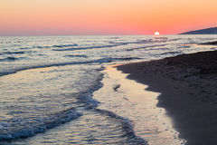Blue waves of adriatic sea during sunset. Beautiful blue waves of adriatic sea during sunset Royalty Free Stock Images
