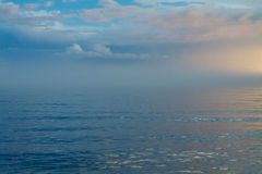 Blue waves with blue sky. And clouds at Baikal lake Stock Photography
