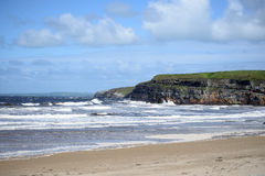 Blue waves and cliffs on the wild atlantic way Royalty Free Stock Image