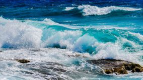 Blue waves coming ashore Royalty Free Stock Photos