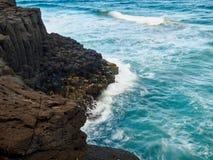 Blue Waves crashing headland Stock Photography