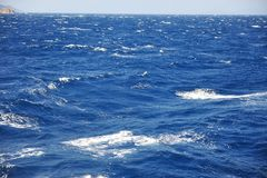 Blue waves in open sea. Background Stock Photos