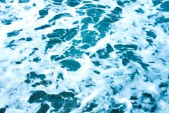 Blue waves pattern of sea foam. Natural background, blue waves pattern of sea foam, marine water Stock Photos