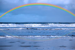 Blue waves and rainbow Stock Images