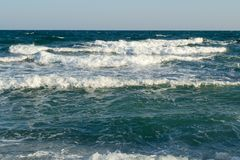 Blue waves. Blue sea waves in a sunny day Royalty Free Stock Photo