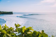 Blue waves for surfing in Bali. Beach and ocean waves. In Indonesia stock image
