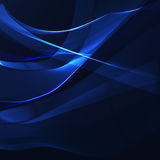 Blue wavy stripes on a dark background Stock Photography
