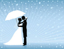 Blue wedding background. Silhouettes of groom and bride standing and hugging on the blue background. Groom holding an umbrella. Raining hearts Stock Photos