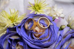 Blue wedding bouquet and rings. Beautiful blue and white fresh flowers wedding bouquet Royalty Free Stock Image