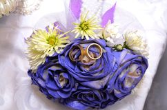 Blue wedding bouquet and rings. Beautiful blue and white fresh flowers wedding bouquet Stock Photography