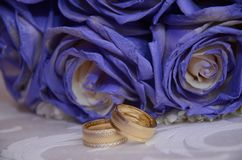 Blue wedding bouquet and rings. Beautiful blue and white fresh flowers wedding bouquet Stock Image