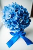 Blue wedding bouquet. On the table Stock Images